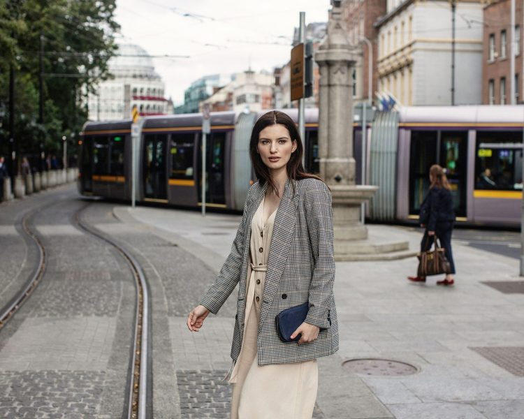 woman walking around dublin train stop